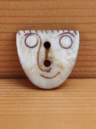 Hand carved - face - button