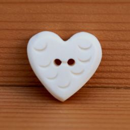 Hand carved - patterned heart - button