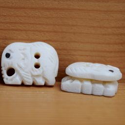 Hand carved - small elephant - button