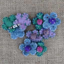 Three flower brooch - hand made felt - gentle blues, mauves and green